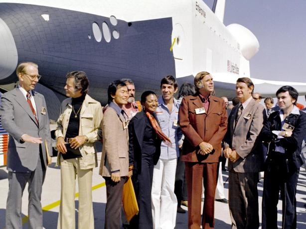 Some actors from Star Trek standing near the Shuttle Enterprise
